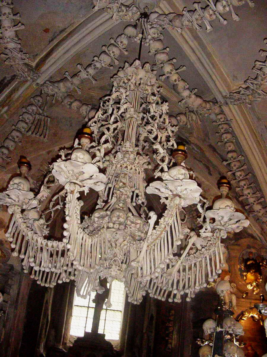 Yikes inside europes super creepy bone churches churchpop heres a closer look at the chandelier made of bones mozeypictures Gallery